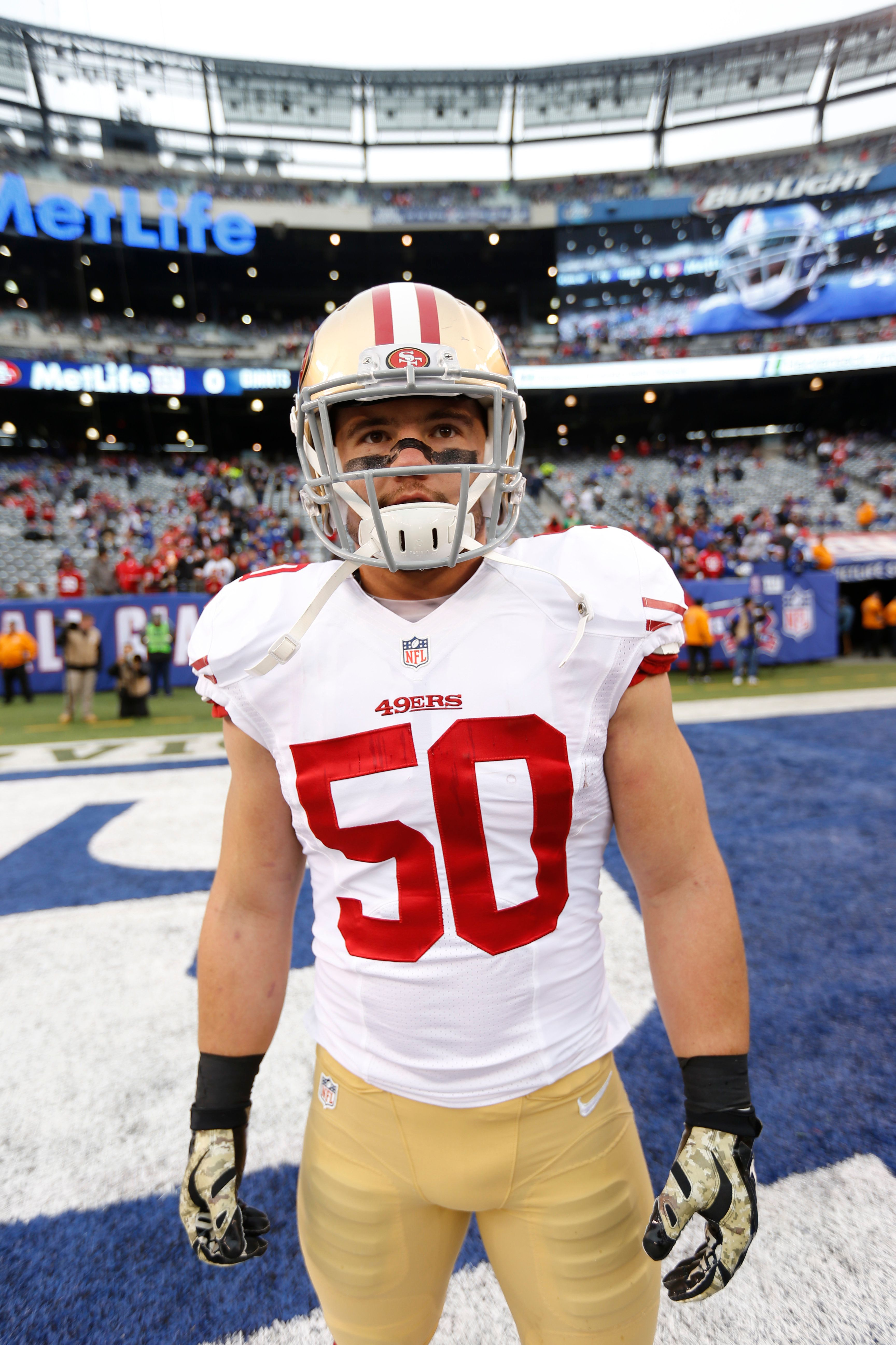 EAST RUTHERFORD, NJ - NOVEMBER 16: Chris Borland #50 of the San Francisco 49ers stands on the field prior to the game against the New York Giants at Metlife Stadium on November 16, 2014 in East Rutherford, New Jersey. The 49ers defeated the Giants 16-10. (Photo by Michael Zagaris/San Francisco 49ers/Getty Images)