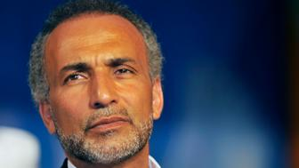 Swiss citizen of Egyptian origin Muslim intellectual and professor Tariq Ramadan gives a speech on August 26, 2011 at the Treichville sports parc, a popular district of Abijdan, during a conference 'Night Destiny (Muslim feast known as Laylat al-Qadr), Night of Peace and Reconciliation'. Laylat Al Qadr, the most important prayer of the fasting month, is the night Muslims commemorate the revelation of the first verses of the Quran to their prophet Mohammed through the angel Gabriel. Muslims spend the night in worship and devotion, praying for the souls of the dead.AFP PHOTO / SIA KAMBOU (Photo credit should read SIA KAMBOU/AFP/Getty Images)