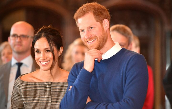 Prince Harry and Meghan Markle watch a performance during a visit to Cardiff Castle on Jan. 18, 2018.
