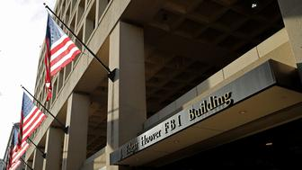 WASHINGTON, DC - MAY 09:  United States flags hang in front of the Federal Bureau of Investigation Edgar J. Hoover Building May 9, 2017 in Washington, DC. On the recommendation of U.S. Attorney General Jeff Sessions, President Donald Trump fired FBI Director James Comey Tuesday.  (Photo by Chip Somodevilla/Getty Images)