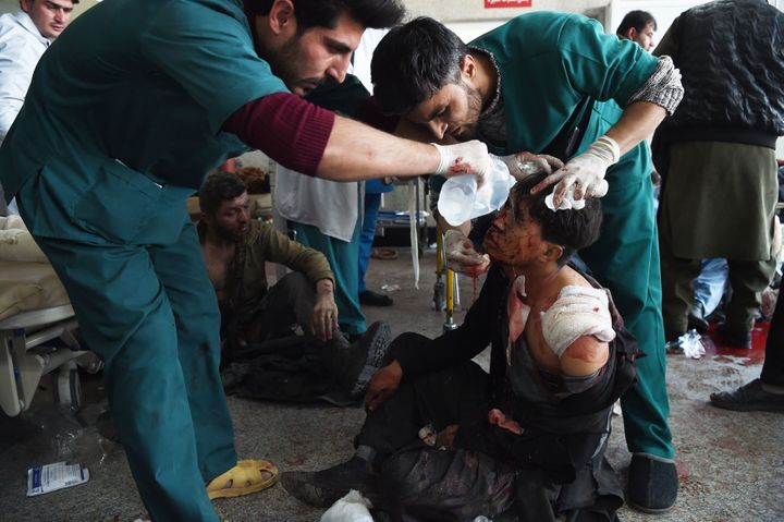 Afghan medical staff treat a wounded man after a car bomb in Kabul on Jan. 27.