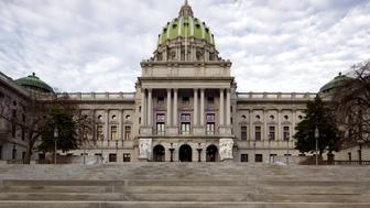 Daylight symmetrical view of Pennsylvania State Capitol in Harrisburg, PA