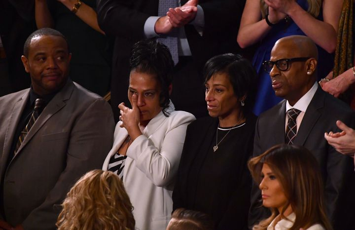 Robert Mickens, left, with his wife, Elizabeth Alvarado, who lost their daughter Nisa, sit with Evelyn Rodriguez, center, and