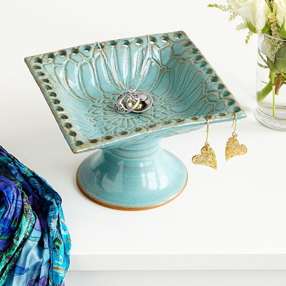 """Get it <a href=""""https://www.uncommongoods.com/product/pedestal-jewelry-holder"""" target=""""_blank"""">here</a>."""