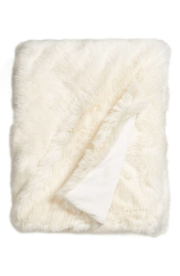 """Get it <a href=""""https://shop.nordstrom.com/s/nordstrom-at-home-cuddle-up-faux-fur-throw-blanket/4328272?origin=category-perso"""