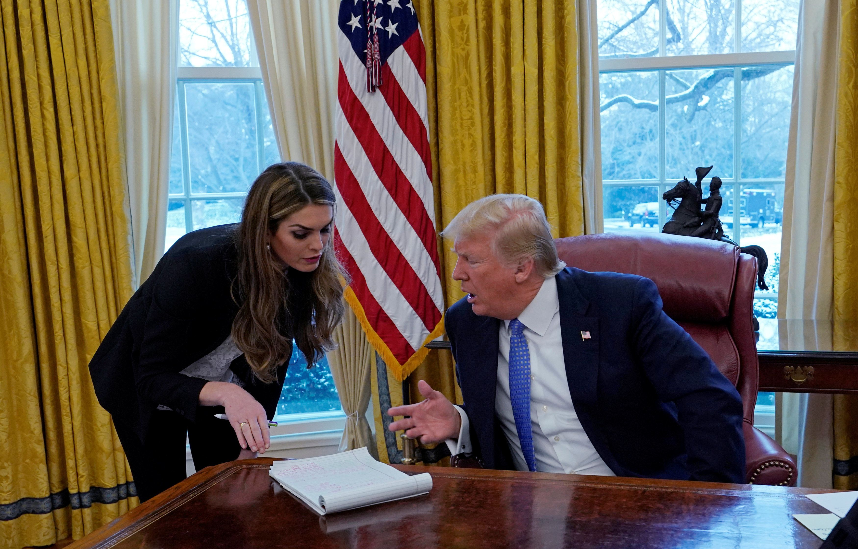 U.S. President Donald Trump confers with White House Communications Director Hope Hicks during an interview with Reuters at the White House in Washington, U.S., January 17, 2018. REUTERS/Kevin Lamarque