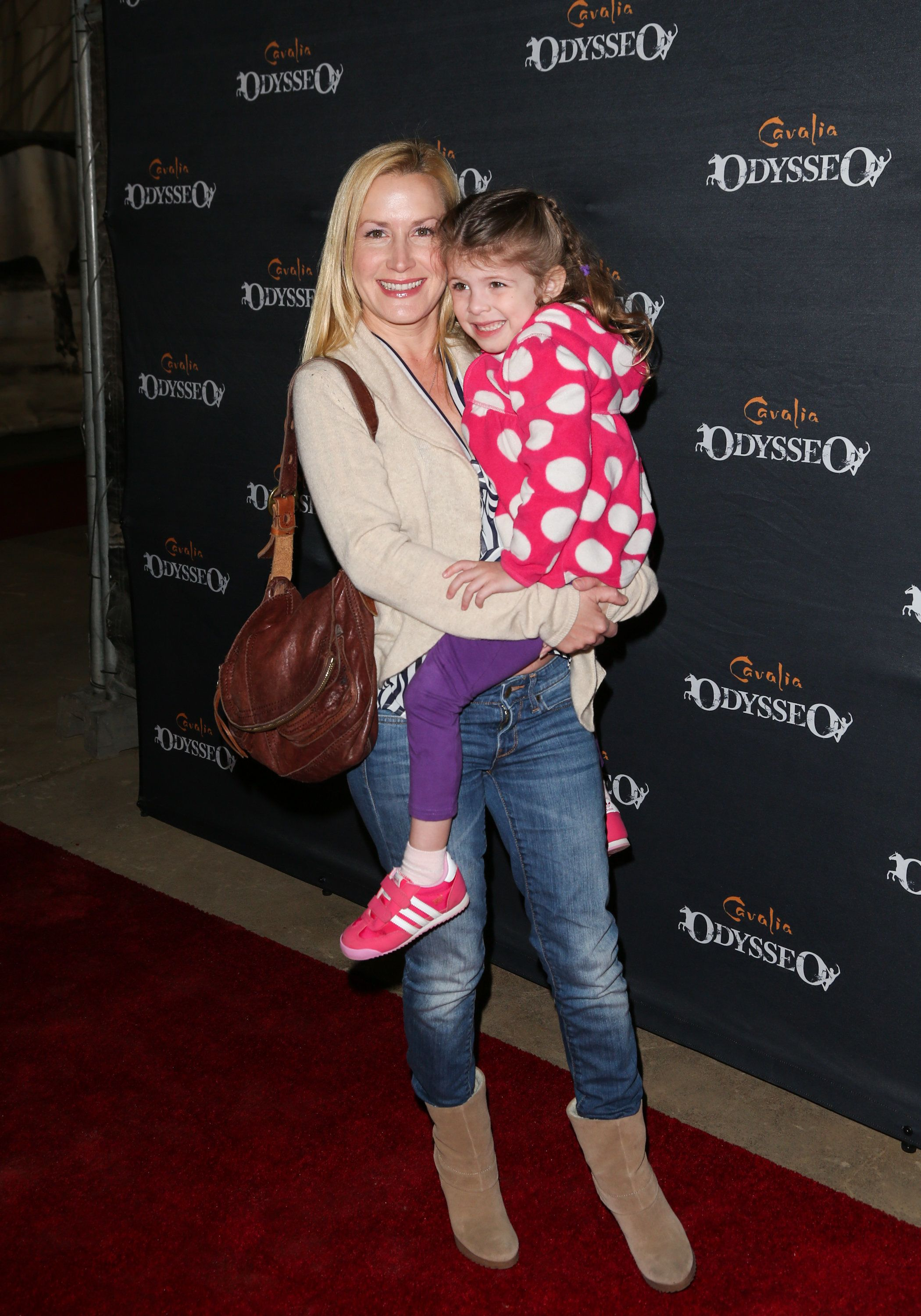 BURBANK, CA - FEBRUARY 27:  Actress Angela Kinsey (L) and her daughter Isabel Ruby Lieberstein (R) attend the opening night for Cavalia's 'Odysseo' at the Cavalia's Odysseo Village on February 27, 2013 in Burbank, California.  (Photo by Paul Archuleta/FilmMagic)