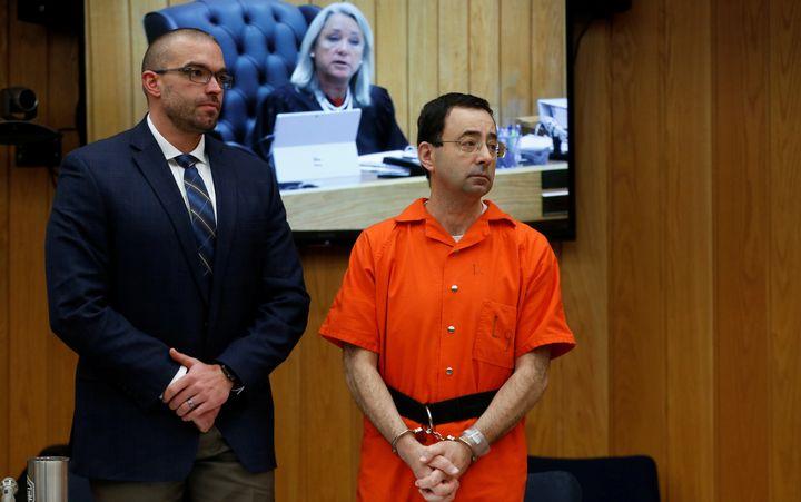 Larry Nassar stands with attorney Matt Newburg during his second sentencing hearing on Jan. 31.