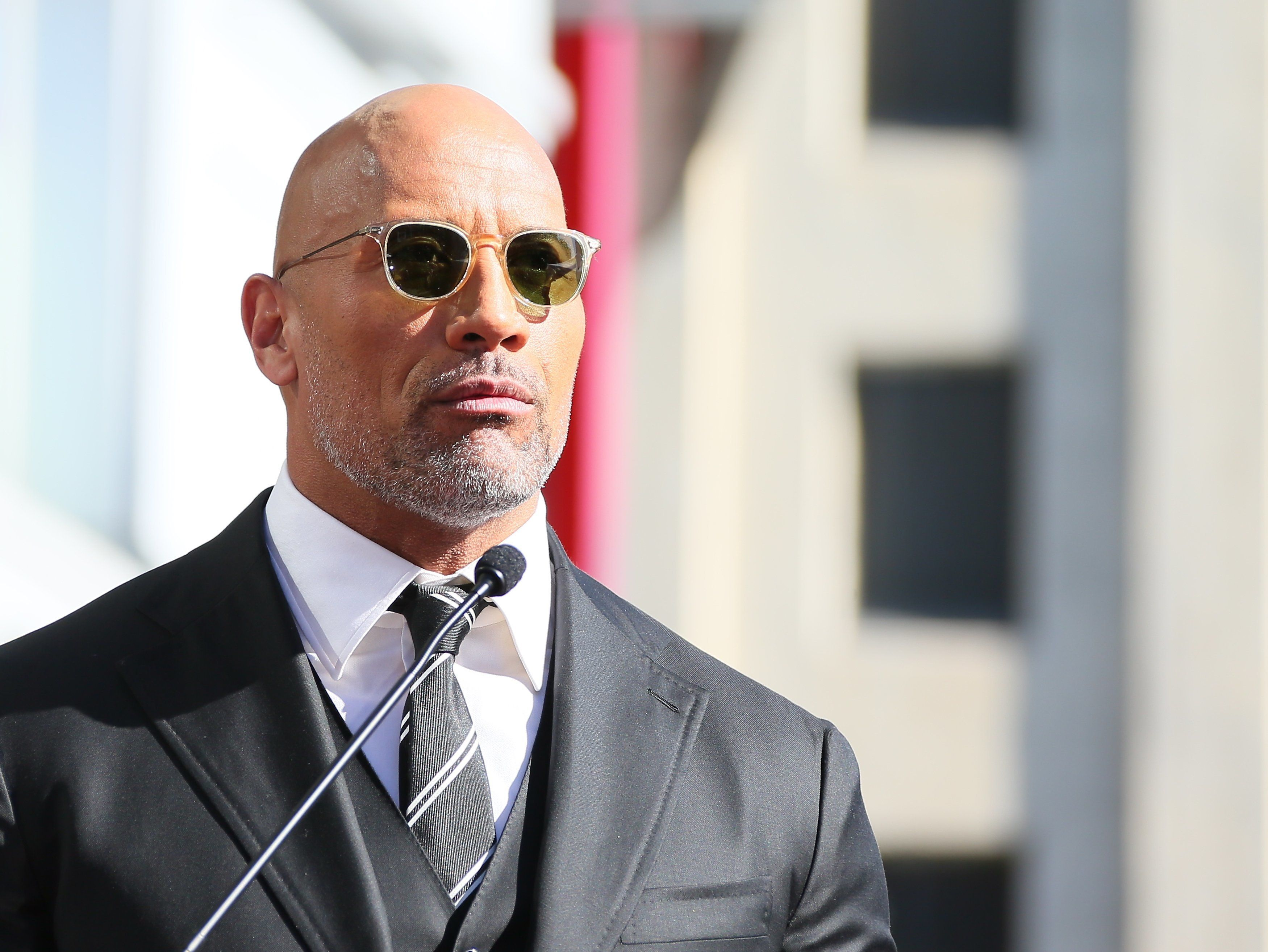LOS ANGELES, CA - DECEMBER 13: Dwayne Johnson is honored with Star On The Hollywood Walk Of Fame on December 13, 2017 in Los Angeles, California.(Photo by JB Lacroix/ WireImage)