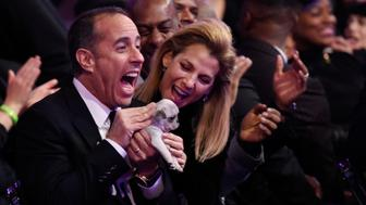 NEW YORK, NY - JANUARY 28:  Comedian Jerry Seinfeld receives a consolation puppy during the 60th Annual GRAMMY Awards at Madison Square Garden on January 28, 2018 in New York City.  (Photo by Kevin Mazur/Getty Images for NARAS)