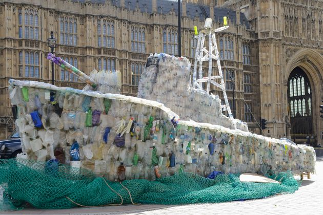A boat made of plastic bottles, is seen outside the Parliament, in London on September 13, 2017. The...