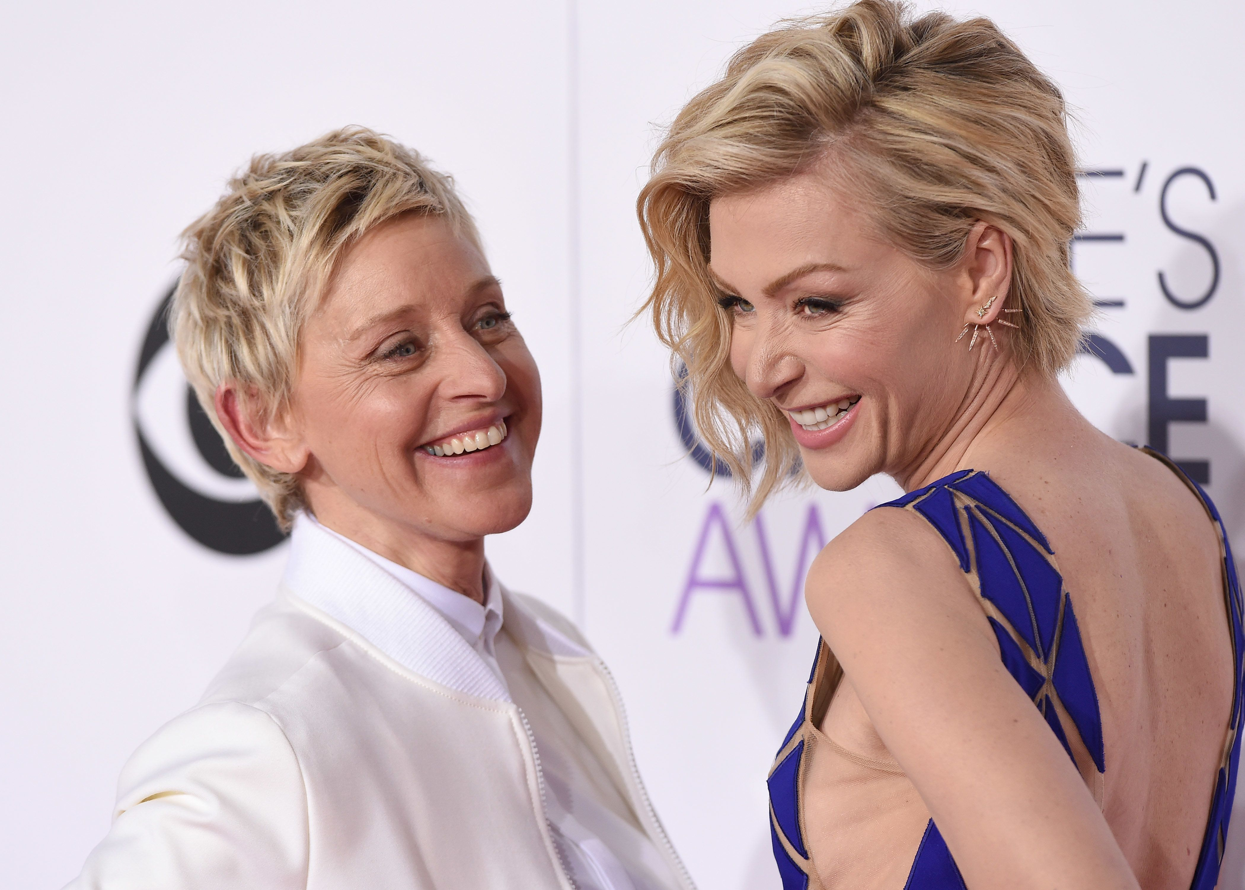 LOS ANGELES, CA - JANUARY 07:  TV personality Ellen DeGeneres (L) and actress Portia de Rossi arrive at The 41st Annual People's Choice Awards at Nokia Theatre LA Live on January 7, 2015 in Los Angeles, California.  (Photo by Axelle/Bauer-Griffin/FilmMagic)
