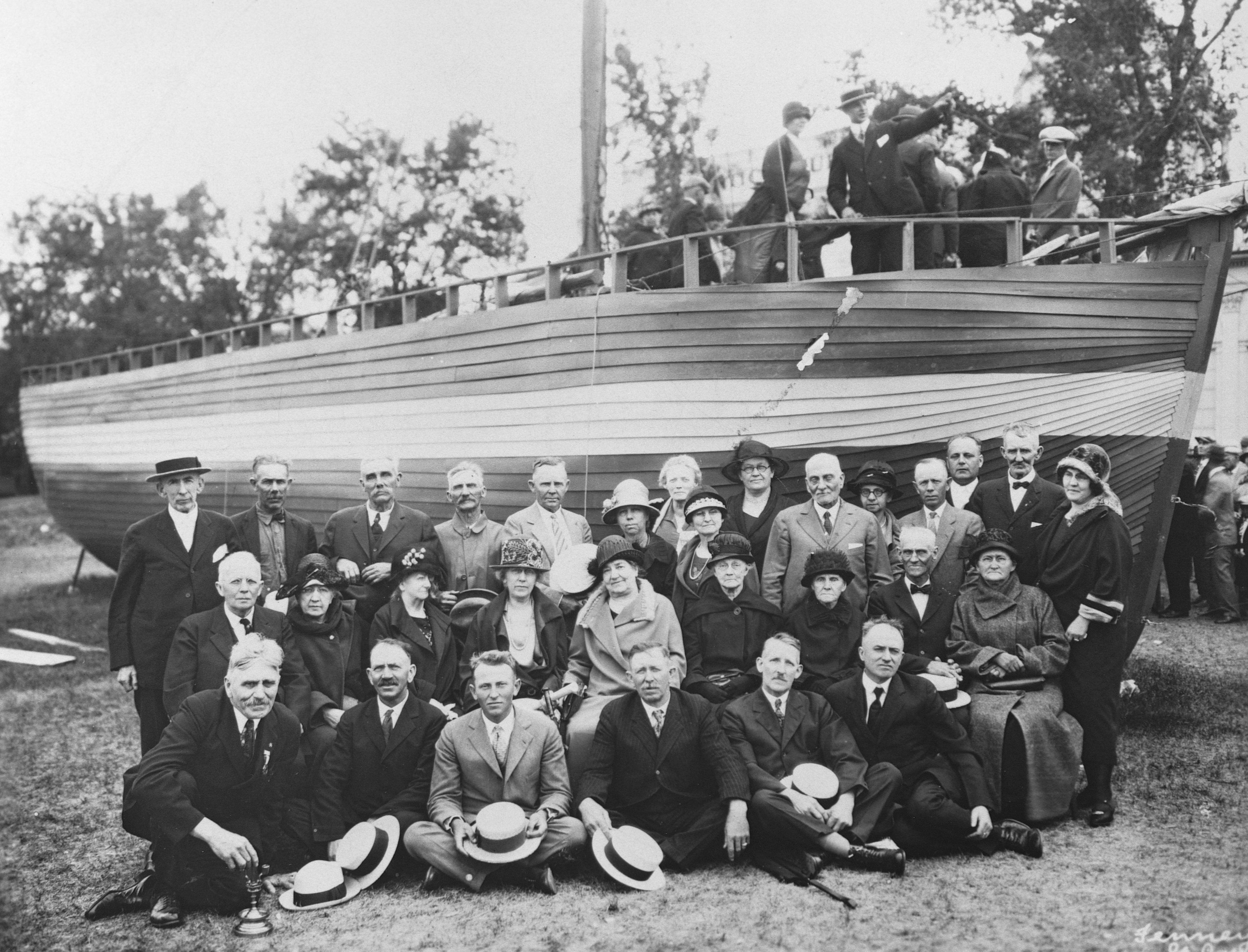 Descendants of Norwegian immigrants poseat the Minnesota State Fairgrounds by the sloop on which their ancestors came t
