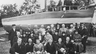Descendants of Norwegian immigrants posed by the sloop on which their ancestors came to America, The sloop has been named 'Restoration'. Minnesota State Fairgrounds, 1925. (Photo by © Minnesota Historical Society/CORBIS/Corbis via Getty Images)
