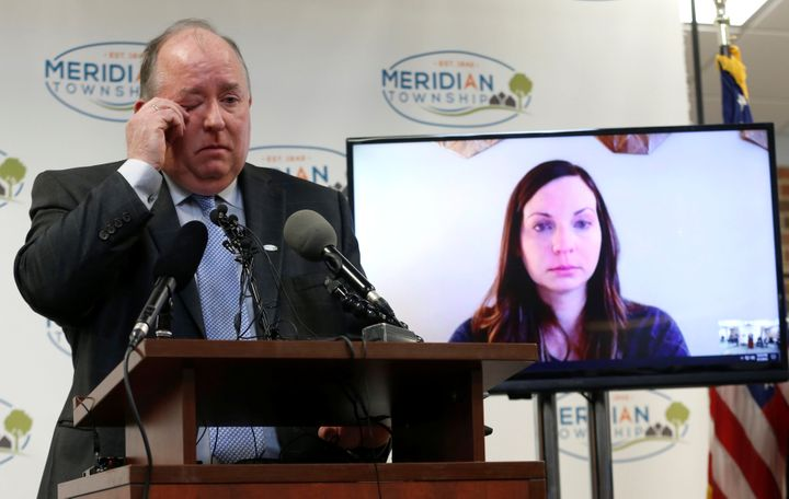 Meridian Township manager Frank Walsh apologizes tosexual assault survivor Brianne Randall-Gay (on video screen) on Feb