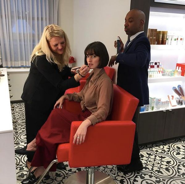 Getting my makeup done and hair styledduring my makeover at the Red Door Salon in Chicago.