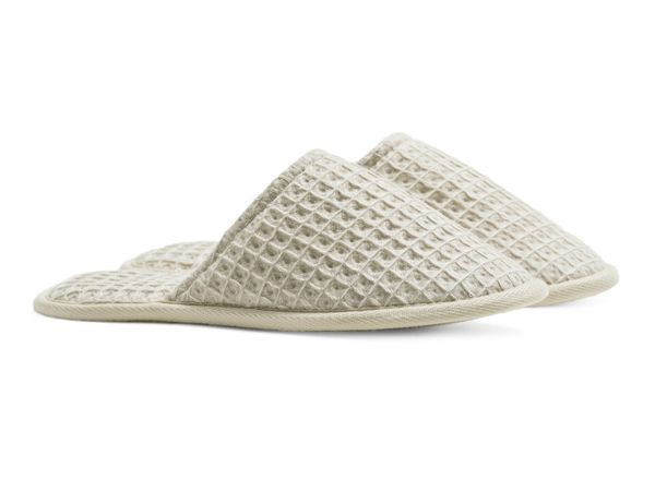 "Get them at <a href=""https://www.parachutehome.com/products/waffle-slippers?variant=43723862868"" target=""_blank"">Parachute</a"