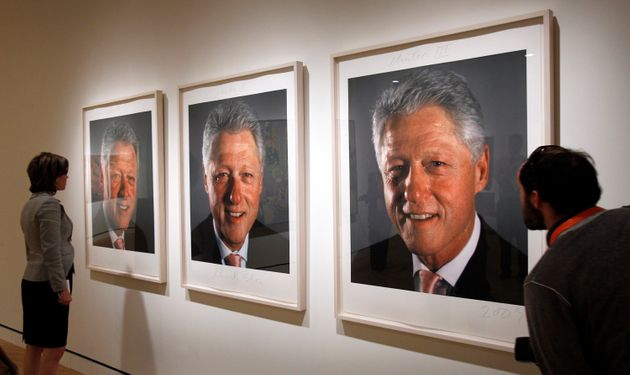 Three photographs of former President Bill Clinton by Chuck Close that were used for a painting hang...