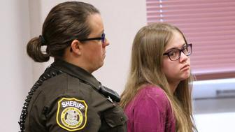 Here Morgan Geyser is brought into court by a sheriff's deputy on Aug. 21, 2015 during the arraignment of the Slenderman stabbing trial in Waukesha County Court in Waukesha, Wis. The court entered a not guilty plea for them and moved to set a trial date in mid-October. (Michael Sears/Milwaukee Journal Sentinel/TNS via Getty Images)