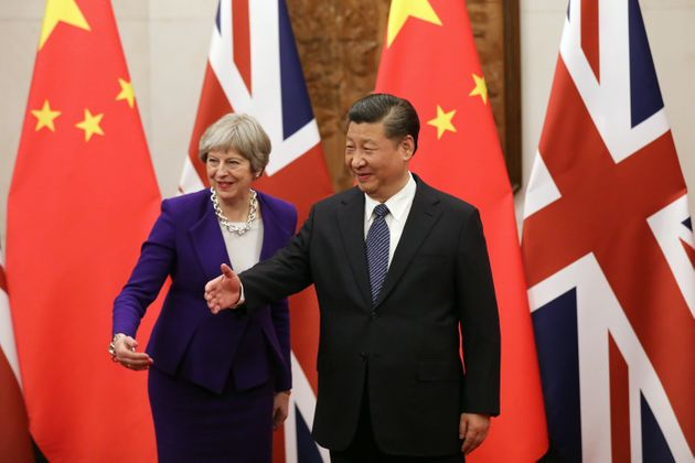 Theresa May 'Side-Stepped' Human Rights In Xi Jinping Talks, Chinese Media