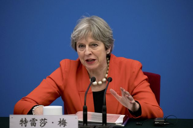 Theresa May, pictured above in Beijing, China, has refused to sack Brexit Minister Steve