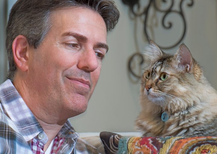 Humane Society CEO Wayne Pacelle at home with his cat Zoe in Chevy Chase, Maryland, on August 31, 2016.