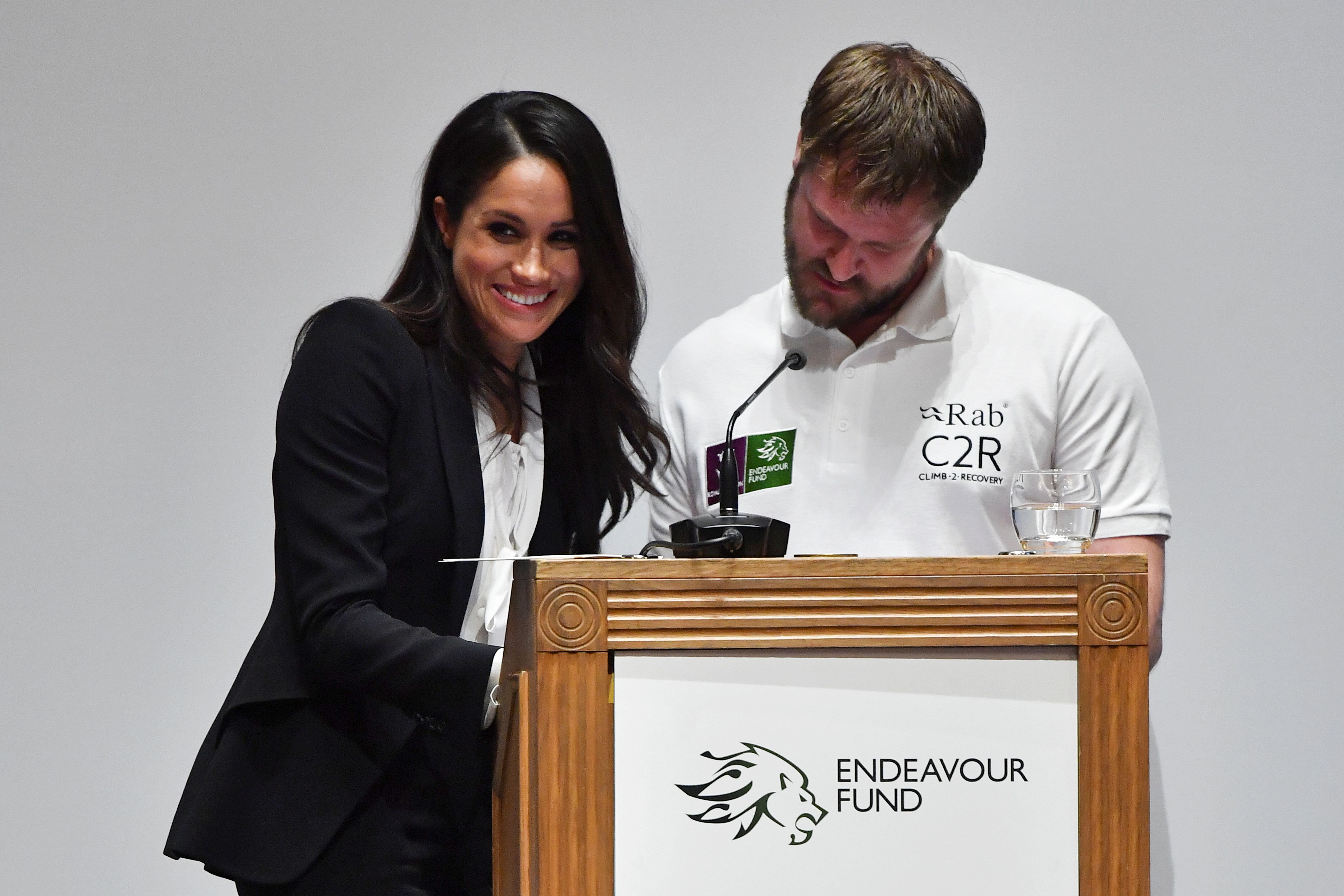 Britain's Prince Harry's fiancee U.S. actor Meghan Markle helps with the award presentations at the annual Endeavour Fund Awards at Goldsmiths' Hall in London, Britain February 1, 2018. Picture taken February 1, 2018. REUTERS/Ben Stansall/Pool