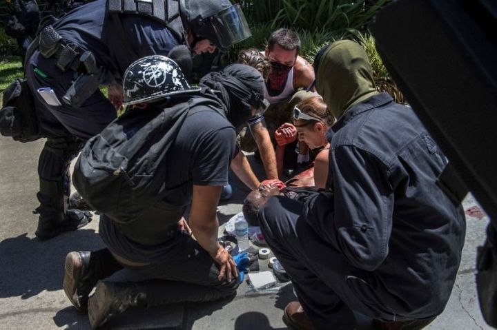 A stabbing victim is attended to during a neo-Nazi rally in Sacramento, Calif., June 26, 2016.