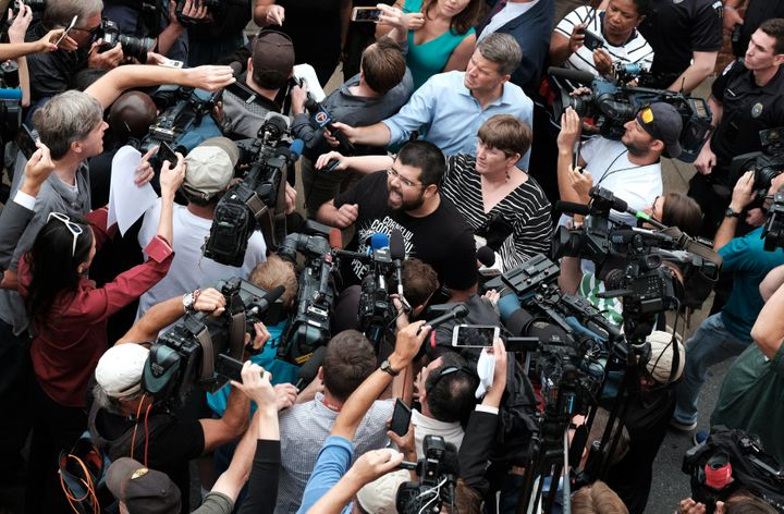 White nationalist leader Matthew Heimbach (C) screams at the media in defense of James Alex Fields Jr. outside of Fields bail