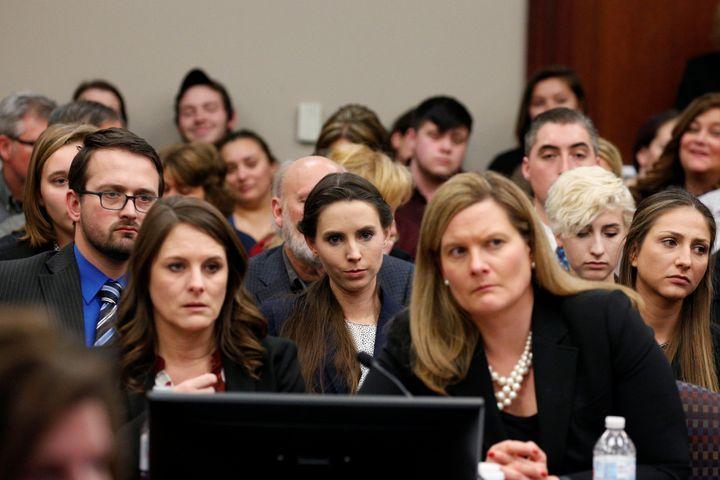 Rachael Denhollander (center) listens as Larry Nassar is sentenced.