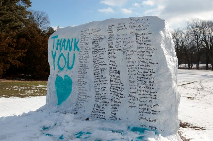 A boulder on the campus of Michigan State University is painted with the names of assault victims of Larry Nassar.