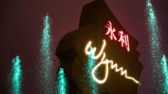 A fountain sprays water in front of signage outside the Wynn Macau casino resort, operated by Wynn Resorts Ltd., in Macau, China, on Tuesday, Jan. 30, 2018. Wynn Macau said it will cooperate with regulators after the government of the Chinese territory voiced concern over sexual harassment allegations swirling around casino magnate Steve Wynn. Photographer: Billy H.C. Kwok/Bloomberg via Getty Images