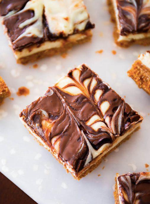 "<strong>Get the <a href=""http://sallysbakingaddiction.com/2013/11/30/nutella-swirl-cheesecake-bars/"" target=""_blank"">Nutella"