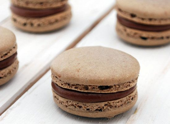 """<strong>Get the <a href=""""http://www.cakeandallie.com/2011/07/chocolate-nutella-macarons/"""">Chocolate & Nutella Macarons recipe"""