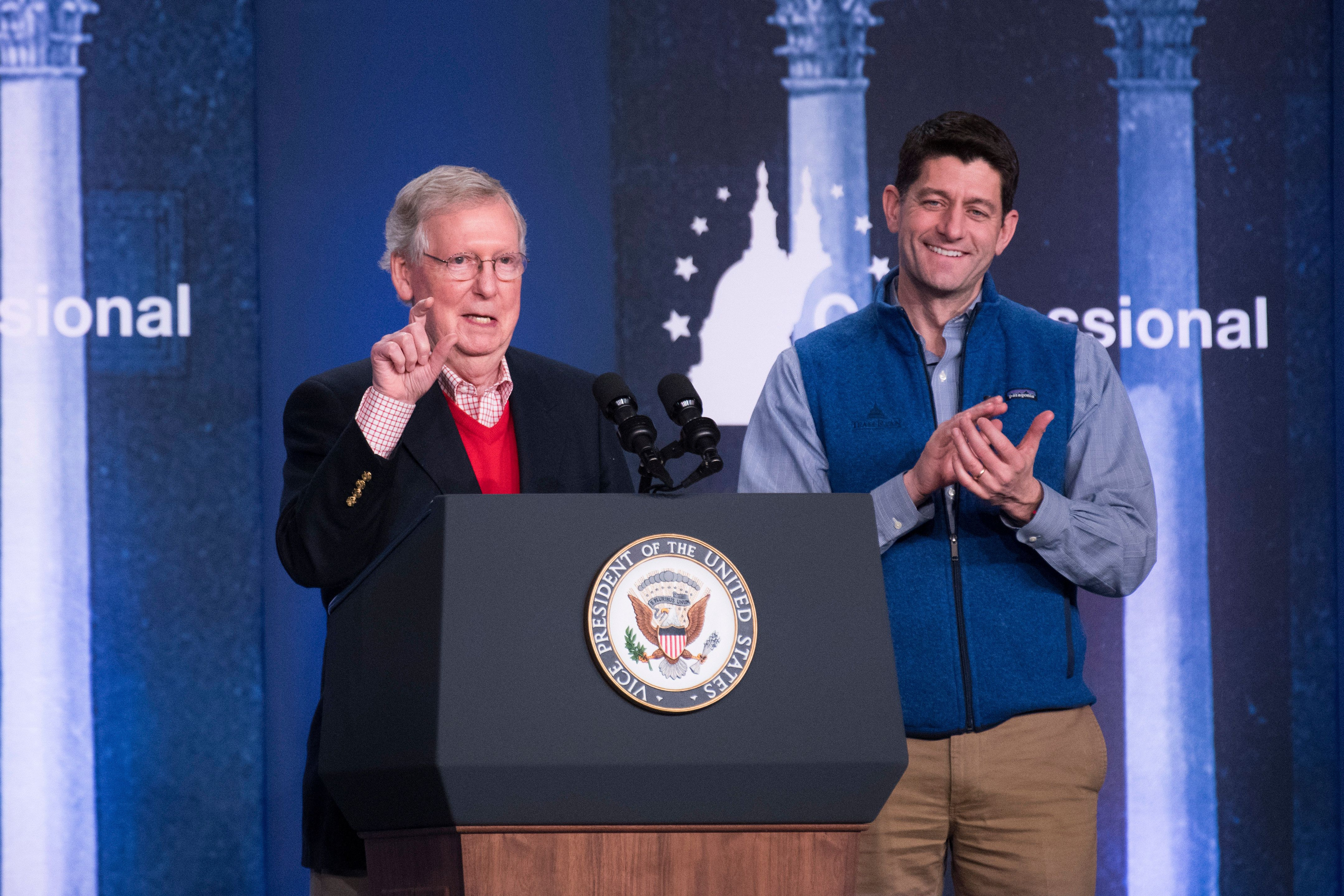 UNITED STATES - JANUARY 31: Senate Majority Leader Mitch McConnell, R-Ky., left, and Speaker Paul Ryan, R-Wis., introduce Vice President Mike Pence during a dinner at the House and Senate Republican retreat at The Greenbrier resort in White Sulphur Springs, W.Va., on January 31, 2018. (Photo By Tom Williams/CQ Roll Call)