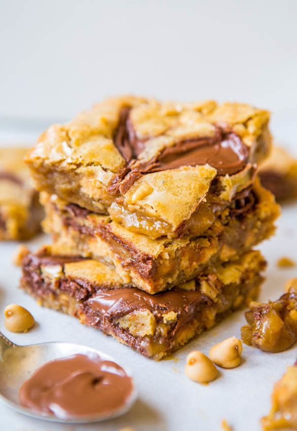"""<strong>Get the <a href=""""https://www.averiecooks.com/2013/08/nutella-swirled-peanut-butter-chip-blondies.html"""" target=""""_blank"""