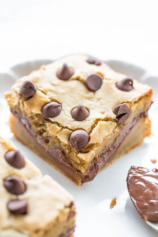 """<strong>Get the <a href=""""https://www.averiecooks.com/2016/07/nutella-stuffed-chocolate-chip-blondies.html"""" target=""""_blank"""">Nu"""