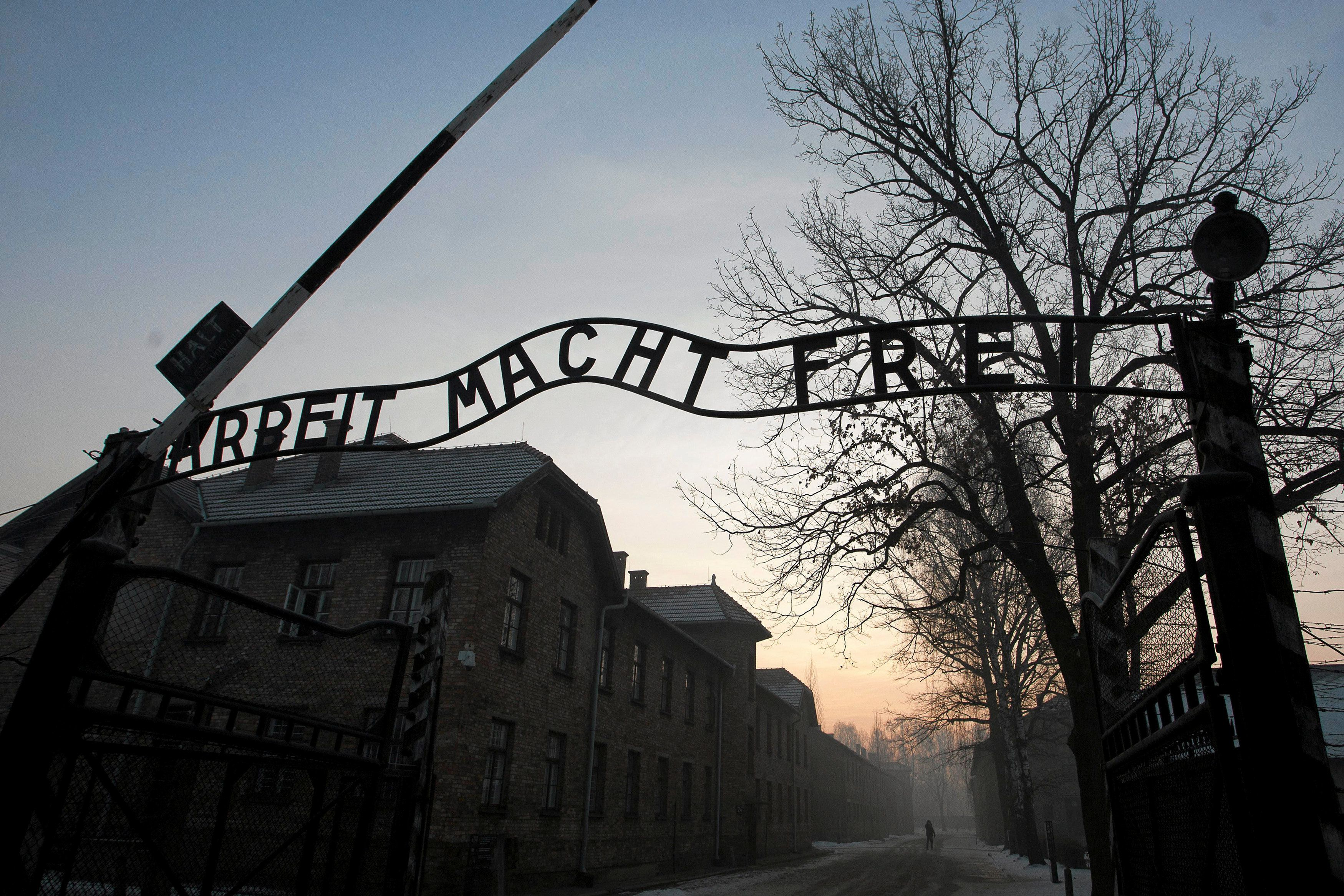 """The Nazi slogan """"Arbeit macht frei"""" (Work sets you free) is pictured at the gates of the former concentration camp Auschwitz-"""