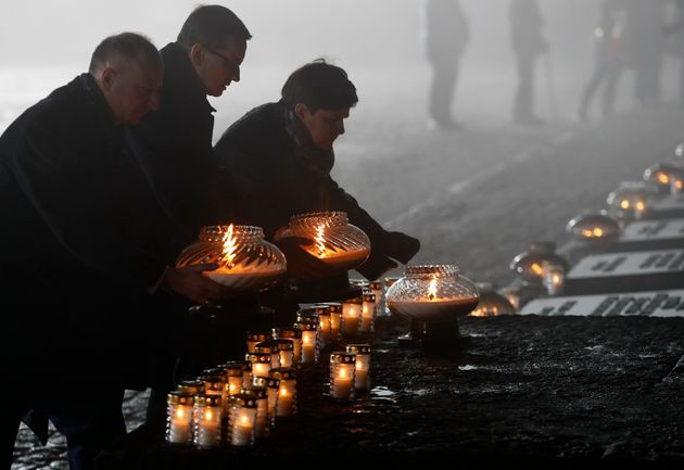 Polish politicians place candles during ceremonies marking the 73rd anniversary of the liberation of...