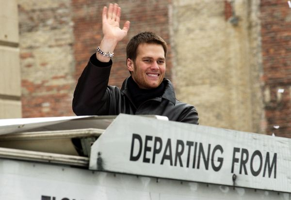 Wavingto crowds along Boylston Street during the team's victory parade on Feb. 8, 2005, in Boston. The Patriots defeate