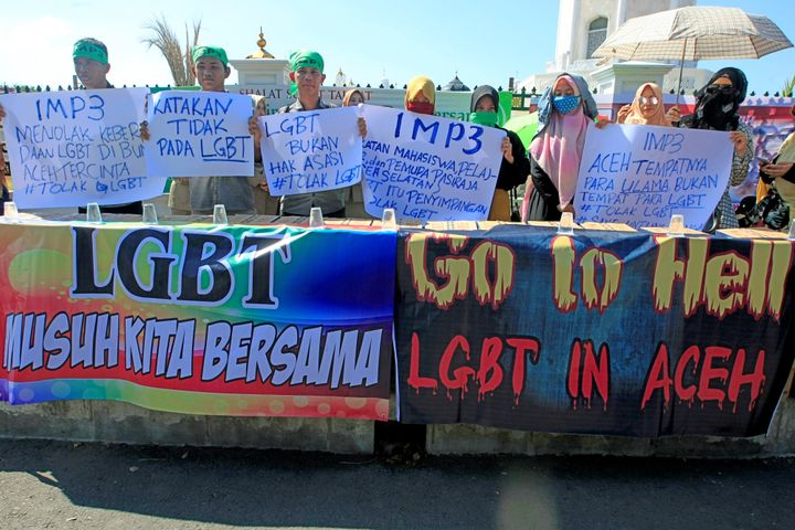 Muslim protesters hold an anti-LGBTQ rally outside a mosque in Indonesia's Aceh province.