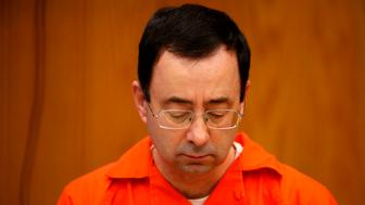 Former Michigan State University and USA Gymnastics doctor Larry Nassar sits during the sentencing phase in Eaton, County Circuit Court on January 31, 2018 in Charlotte, Michigan.  The number of identified sexual abuse victims of former USA Gymnastics doctor Larry Nassar has grown to 265, a Michigan judge announced Wednesday as a final sentencing hearing commenced. Prosecutors said at least 65 victims were to confront Nassar in court, in the last of three sentencing hearings for the disgraced doctor who molested young girls and women for two decades in the guise of medical treatment.  / AFP PHOTO / JEFF KOWALSKY        (Photo credit should read JEFF KOWALSKY/AFP/Getty Images)