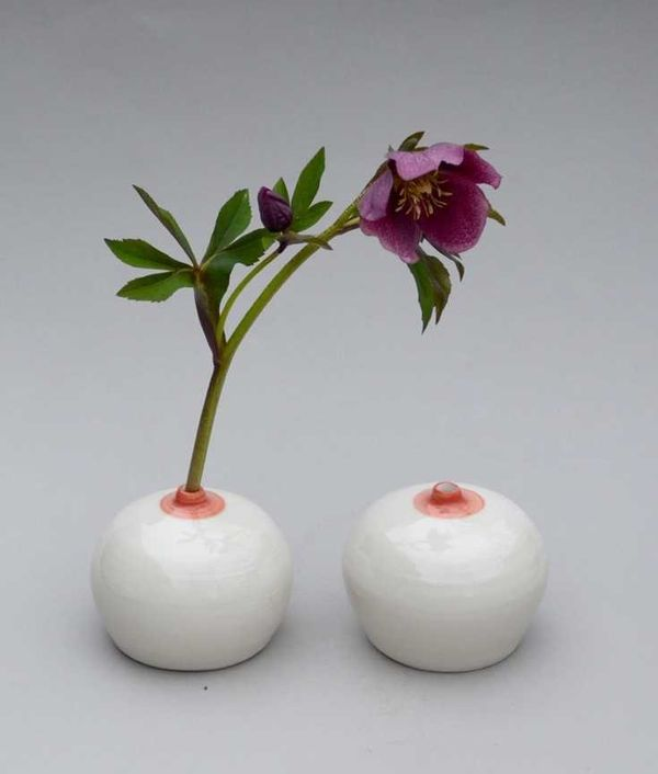 "Dad would have to be a blooming idiot not to appreciate these <a href=""https://tictail.com/danabechert/boob-vase-pair"">totall"
