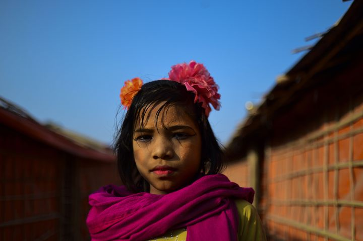 A Rohingya refugee girl poses at a camp in Bangladesh.