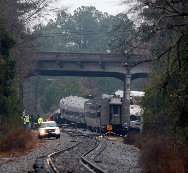 Emergency responders are at the scene after an Amtrak passenger train collided with a freight train in...