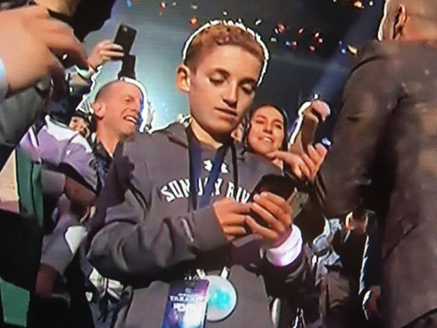 This Kid Looking At His Phone Is The Super Bowl's Best
