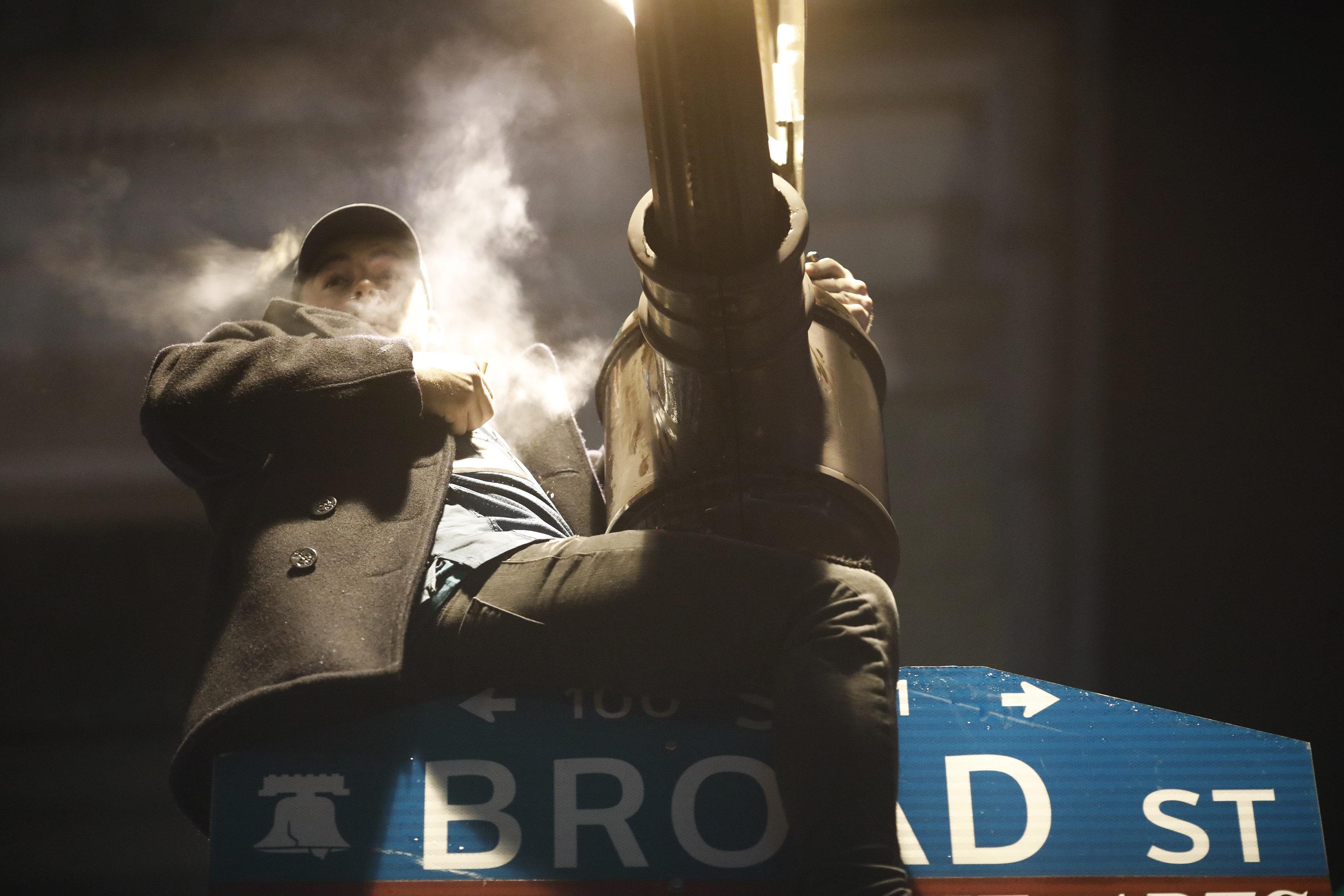 Philly Fans Scale Buildings, Climb Poles, Set Fires After Super Bowl