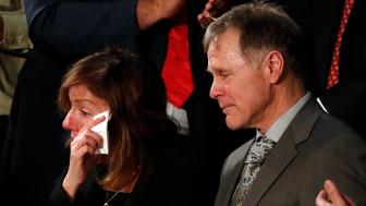 American student Otto Warmbier's parents Fred and Cindy Warmbier cry as U.S. President Donald Trump talks about the death of their son after his arrest in North Korea during the State of the Union address to a joint session of the U.S. Congress on Capitol Hill in Washington, U.S. January 30, 2018. REUTERS/Leah Millis