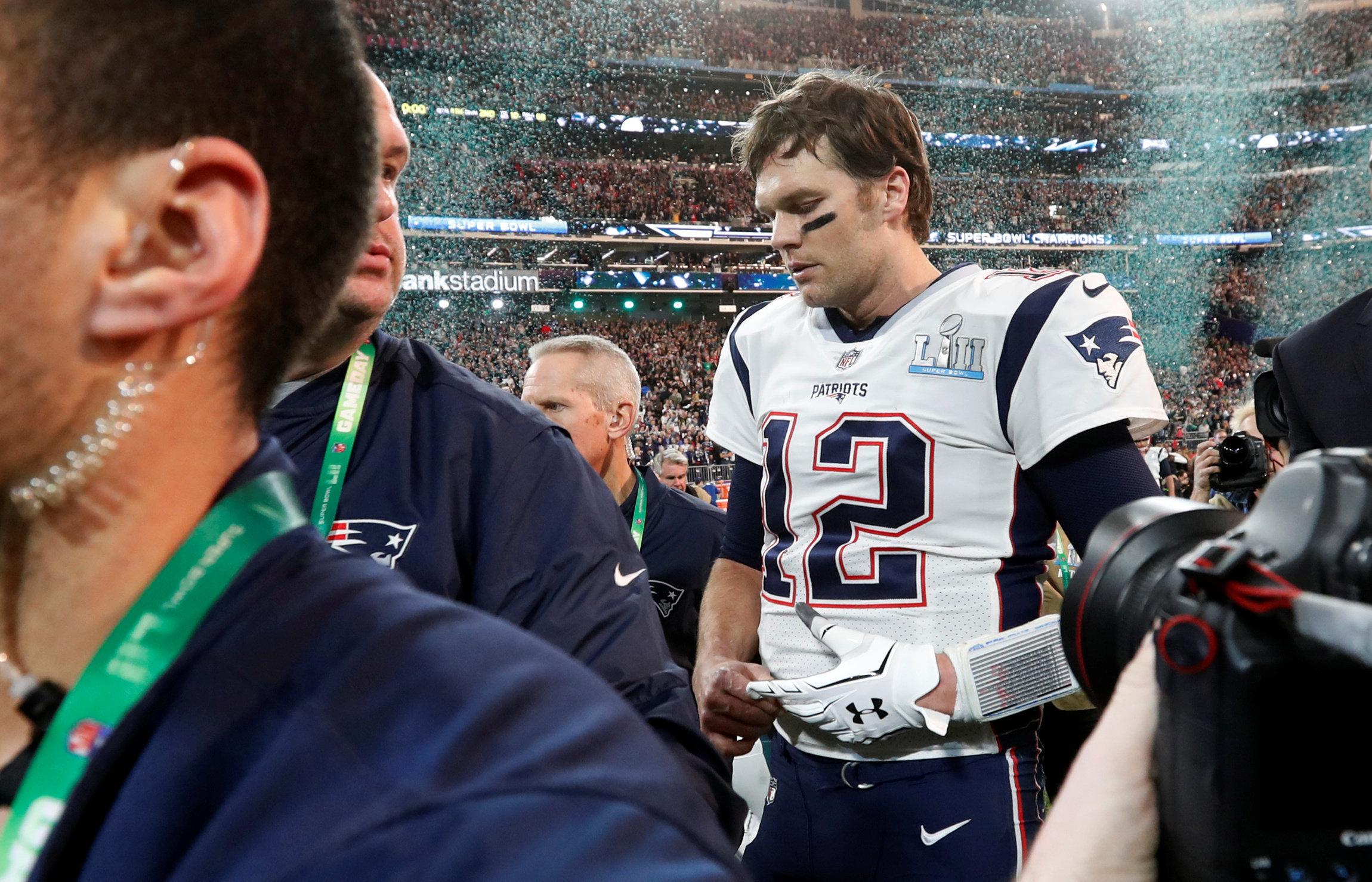 NFL Football - Philadelphia Eagles v New England Patriots - Super Bowl LII - U.S. Bank Stadium, Minneapolis, Minnesota, U.S. - February 4, 2018  New England Patriots' Tom Brady walks off dejected after the game  REUTERS/Kevin Lamarque
