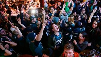 PHILADELPHIA, PA - FEBRUARY 04: Sara-Paige Silvestro  (C) of Barrington, New Jersey reacts with a bar full of Eagles fans watching on TV to the moment the Eagles won Super Bowl LII at The Irish Pub on February 4, 2018 in downtown Philadelphia, Pennsylvania. The Philadelphia Eagles defeated the favored New England Patriots winning their first Super Bowl championship 41-33. (Photo by Corey Perrine/Getty Images)